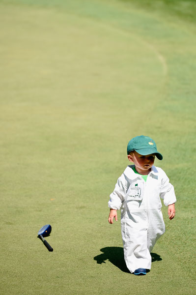 Finn, son of Scott Stallings, makes his way across a green.