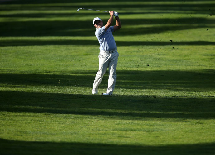Fancesco Molinari of Italy hits a fairway approach to the 17th green. He was tied for second after a 4-under 67.