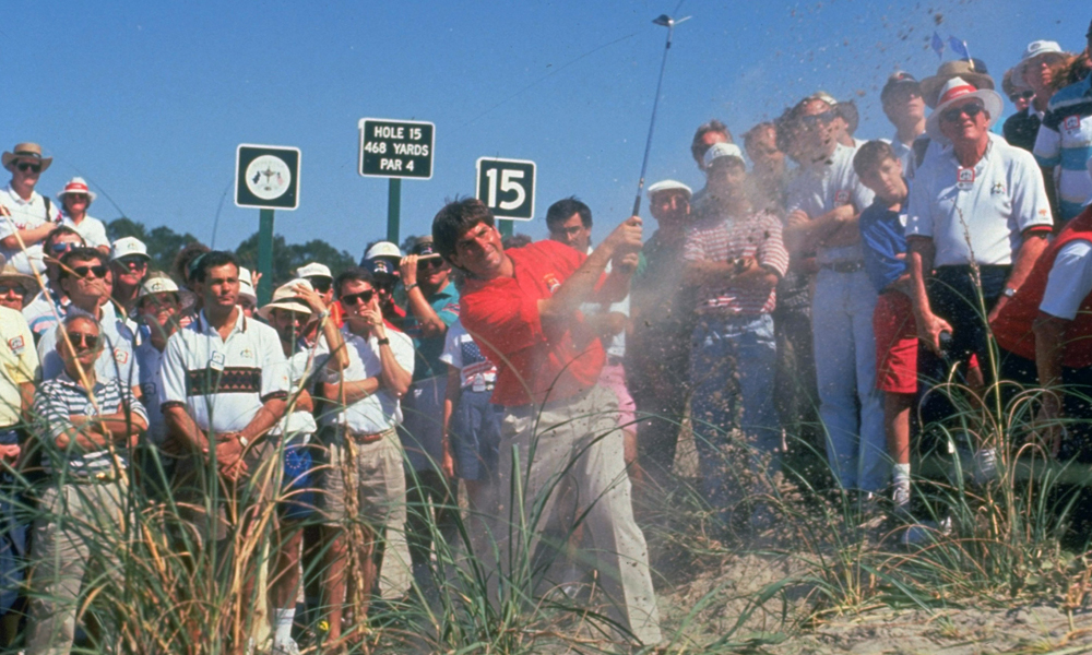 """Fred Couples slashed out of one of Kiawah's dunes during team play. Raymond Floyd said of the course: """"It's so hard it's unbelievable. If you had to play this golf course with a scorecard, I don't see how you could finish."""""""