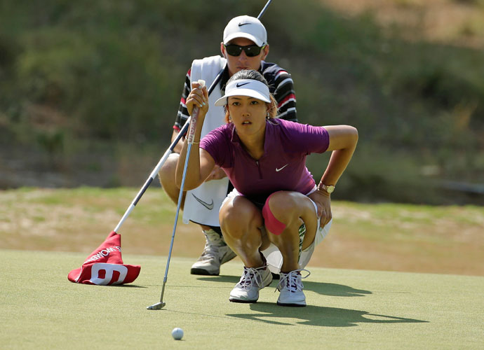 Michelle Wie lines up her putt on the 16th hole.