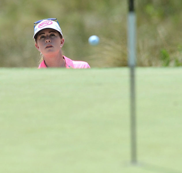 Paula Creamer watches her ball bounce after hitting out of a a bunker on No. 13.