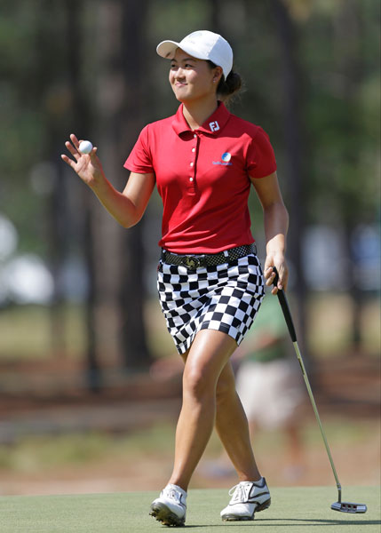 Minjee Lee reacts after making a putt for par on the 12th hole. Lee, an amateur from Australia, was tied for third at even after shooting 69-71 in the first two rounds.