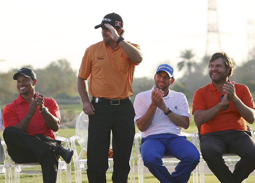 Graeme McDowell saluted the crowd after trying for third. Joining him were Woods, Garcia and Jose Manuel Lara.