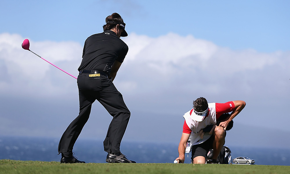 As high winds threatened to knock his ball of the tee, Bubba Watson had some fun with his caddie.
