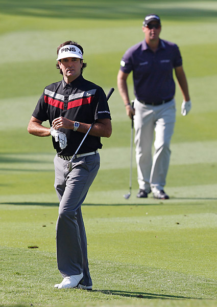 Bubba Watson shot a 66 on Thursday and is one shot back. He played with Peter Hanson (background), who also fired a 66.
