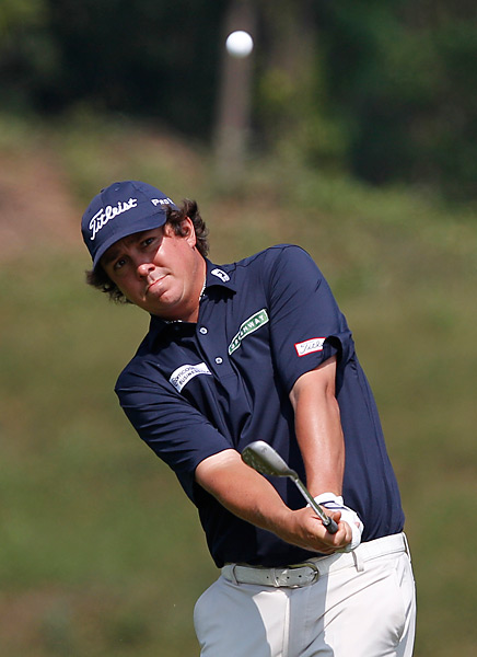 Jason Dufner shot a 64 to climb into a tie for second.