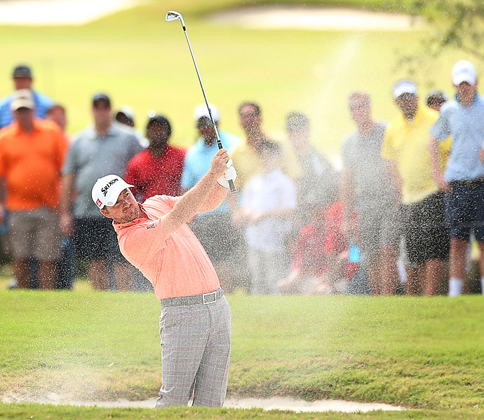 Graeme McDowell played with Woods in the final group. He shot an even-par 72 and tied for third.