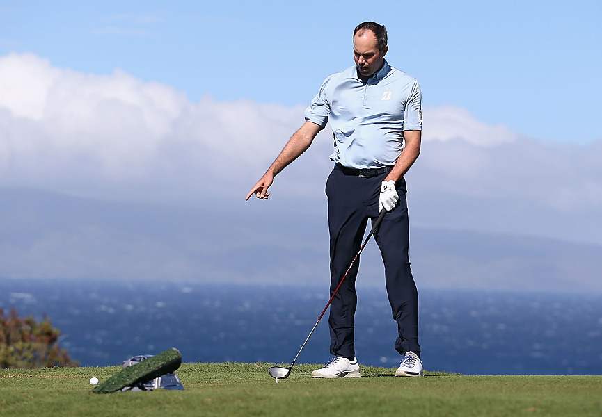 On Sunday at the Plantation Course on Maui, the PGA Tour attempted to start its 2013 season for the third straight day. And for the third straight day, the weather failed to cooperate, as players faced 40 mph wind gusts that made the course unplayable. But before officials called it off, pros played the course in severe conditions for about an hour.                                              Above, Matt Kuchar couldn't keep a hat on his head -- or a ball on his tee -- on the 10th hole, his first, on Sunday.