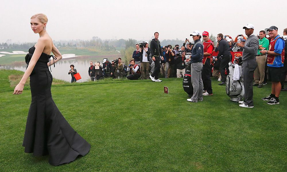 At the match in China, there were several sights not normally seen on a golf course, including a jewelry model on the 12th tee.