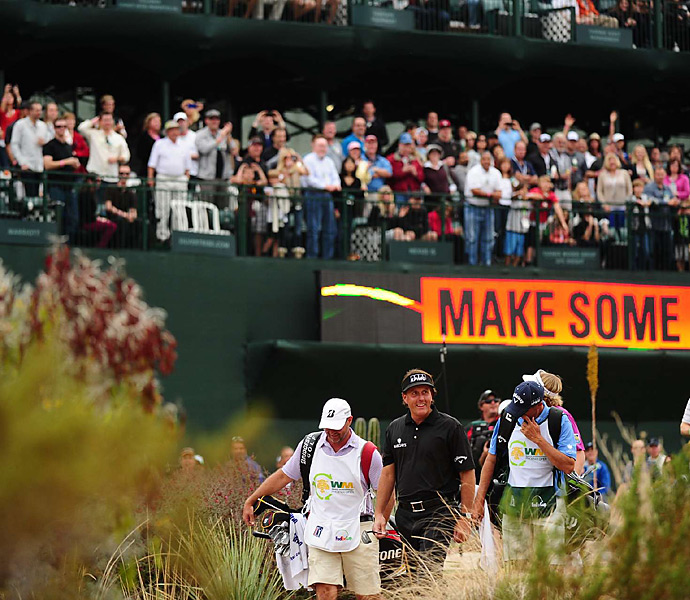 Mickelson had a three-shot lead as he walked off the 16th green on Sunday.