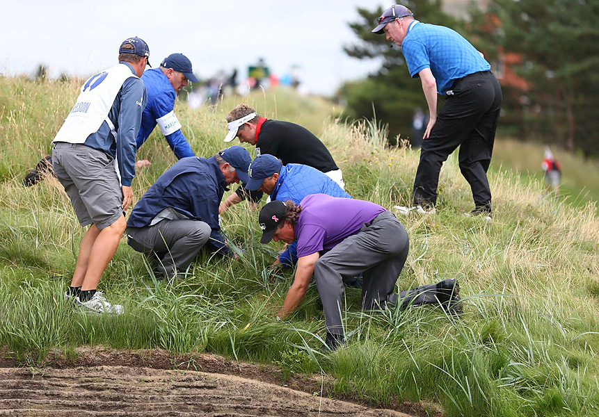 ...but eventually it took a team of people to locate the ball. Mickelson eventually found the ball, and took a penalty drop for an unplayable lie.