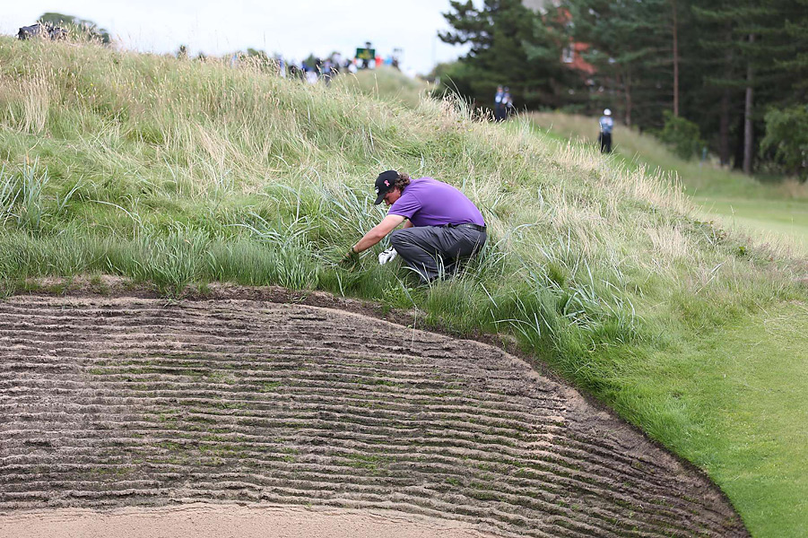 Mickelson began searching for the ball....