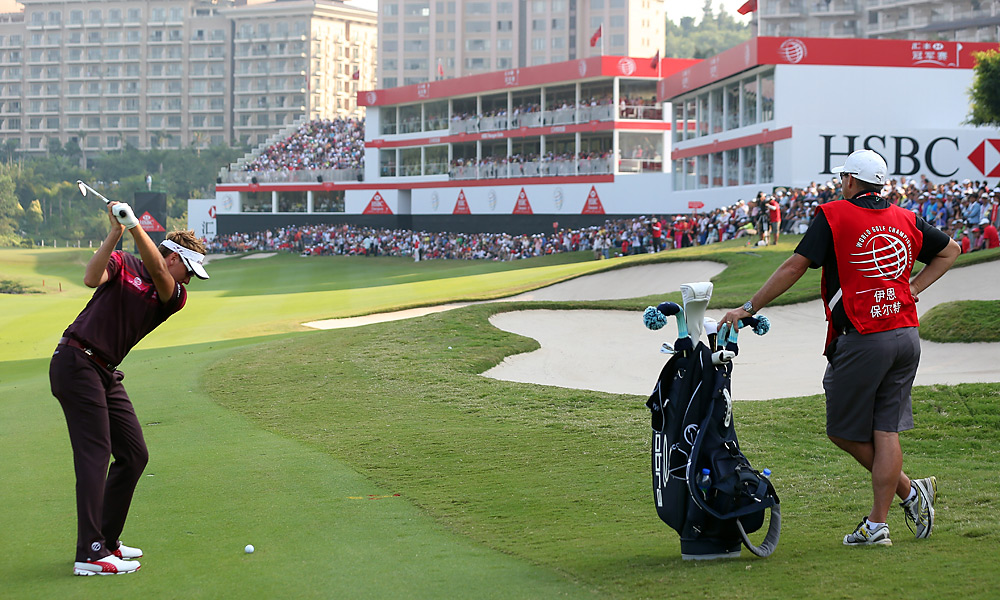 Ian Poulter shot a final-round 65 to erase a four-shot deficit and win the WGC-HSBC Champions by two shots.