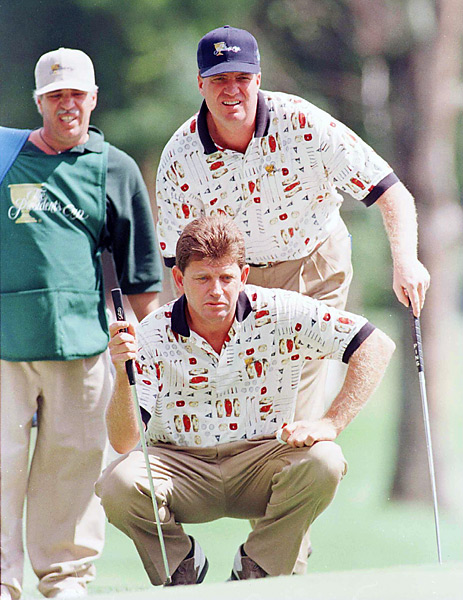 Ruderman says... I wasn't totally clear on what sport Nick Price and Steve Elkington were playing until I got a good look at their polos, which feature an allover print of golf balls, putters and caddy bags. So thanks, guys, for that helpful reminder.