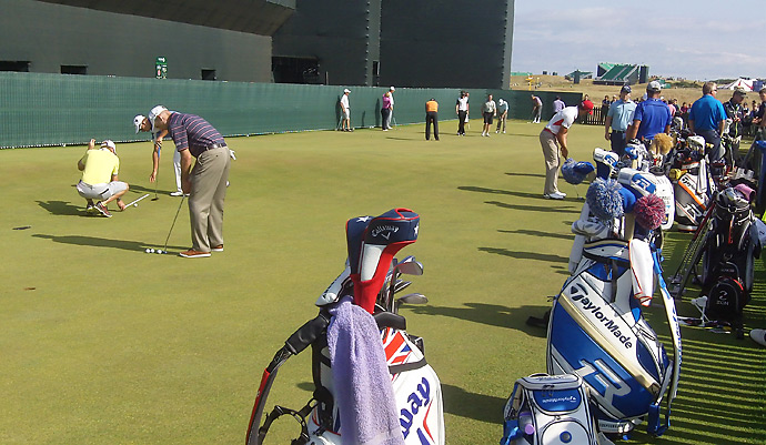Players are spending a lot of time on the practice putting green to acclimate themselves to firm, fast conditions at Muirfield.