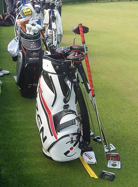 Several club manufacturers have bags full of putters for the pros to try out at the putting green. Here, Zen Golf is showcasing its wares.