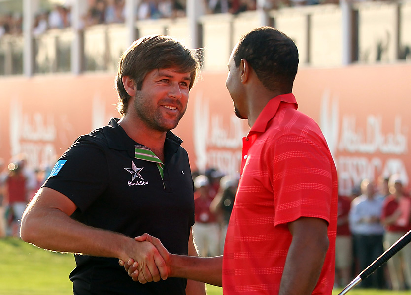 Tiger Woods kicked off his 2012 season at the end of January in the Abu Dhabi HSBC Golf Championship. He was paired with Robert Rock in the final round, but Woods shot a 72 to finish tied for third, while Rock won the title.