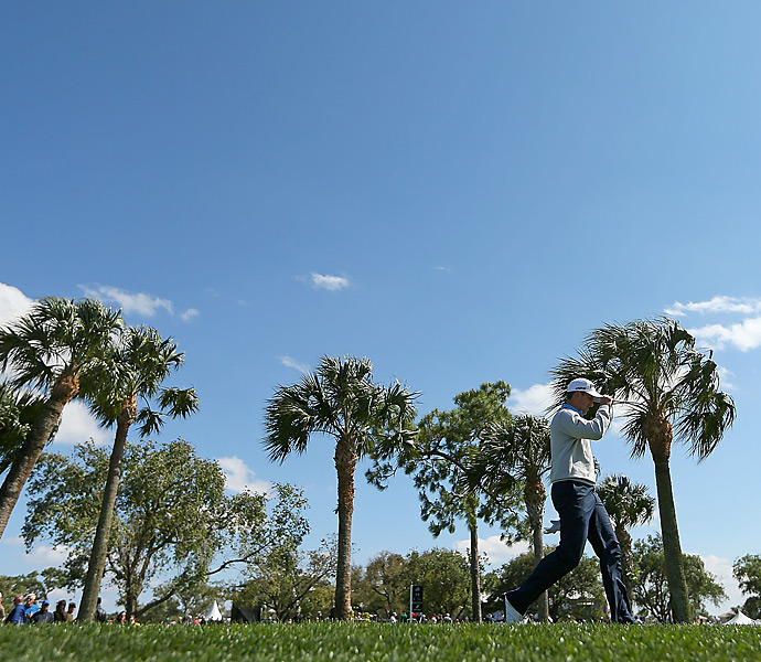 Michael Thompson fired a 69 to fend off Geoff Ogilvy by two shots and win the Honda Classic.