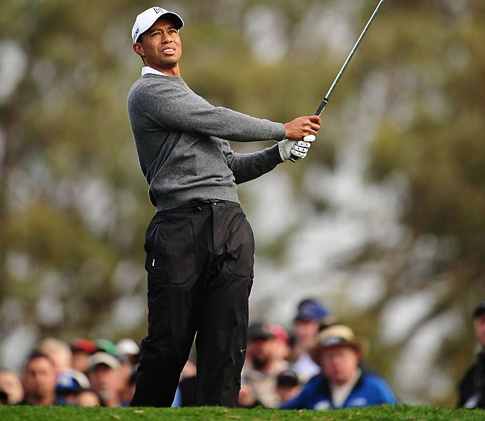 Woods ended play on Sunday with a six-shot lead and 11 holes to go.