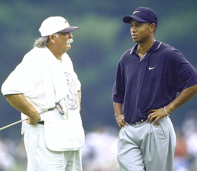 "Tiger Woods and Mike ""Fluff"" Cowan                                              ""(Tiger) came to view Fluff as a Deadhead with a yardage book,"" a source close to the then-23-year-old phenom said after Woods slapped Cowan with a pink slip in 1999. Though Tiger didn't cite a reason, word had it he was miffed at Cowan for speaking publicly about the financial terms of their arrangement. Whatever the case, Fluff seemed philosophical about the firing. ""I will get by. I will survive,"" he said, in an interview with Golf Channel, quoting a lyric from the Grateful Dead."
