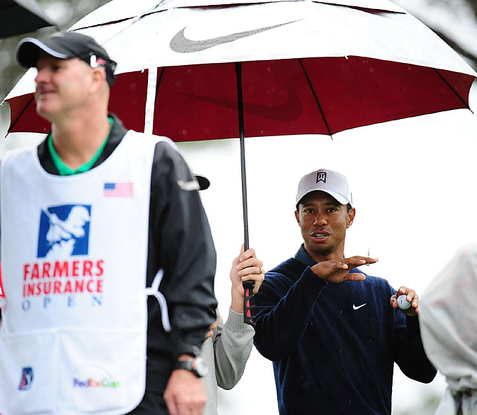 Woods and the rest of the field dealt with soggy conditions throughout the weekend.