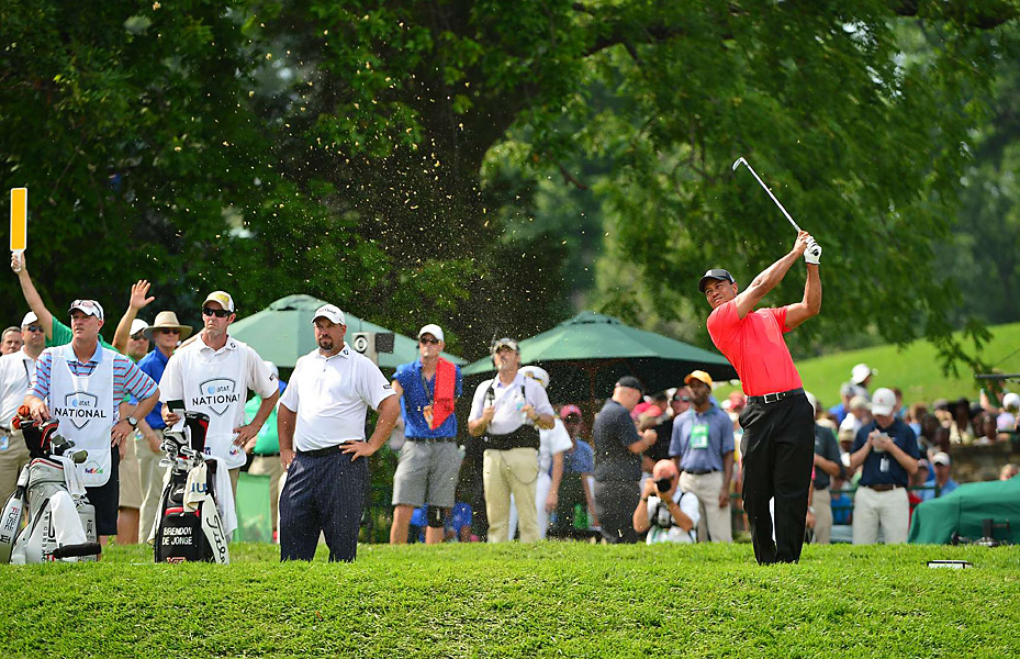 Tiger Woods began the day trailing Brendon de Jonge (far left), but by day's end, he had his third victory of 2012.