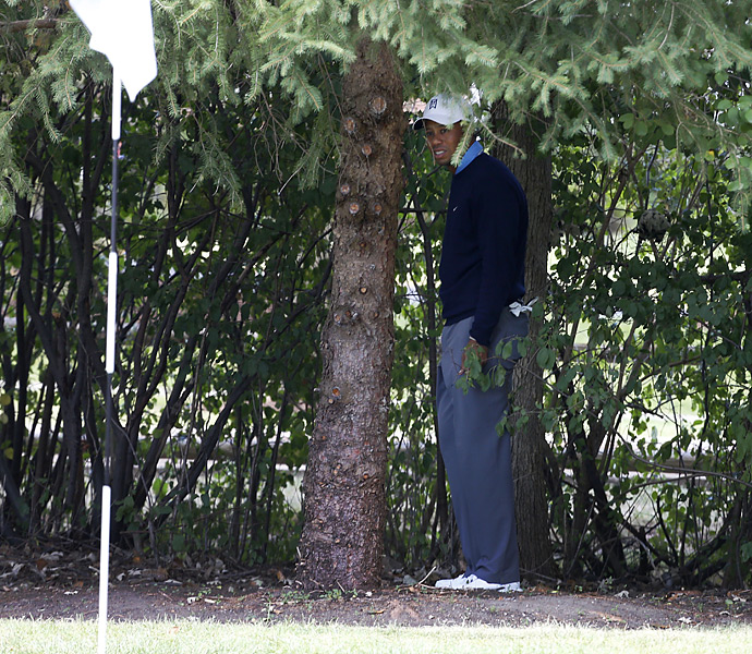 Tiger Woods was hit with a two-shot penalty after the round for moving his golf ball while attempting to remove a nearby twig. The video was captured by a freelancer and sent to Tour officials, who informed Woods of the violation.