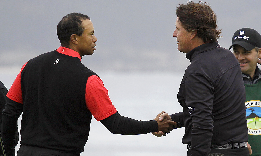 By the time they shook hands, Mickelson had beaten Woods by 11 shots -- 64 to 75.