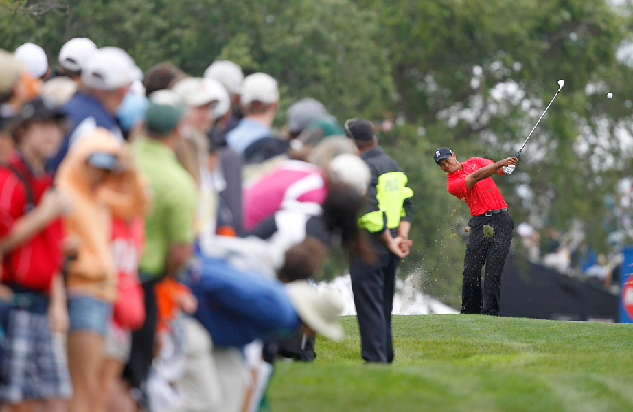 Tiger Woods began the day nine shots behind McIlory.