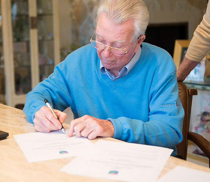Venturi filled out the Hall's requisite paperwork to complete his donation.