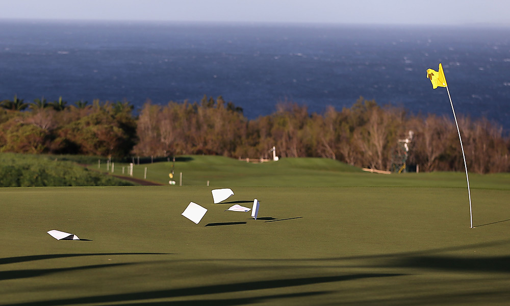 Officials debated Sunday morning before electing to resume play in the afternoon. The golfers played little more than an hour before high winds forced another delay.