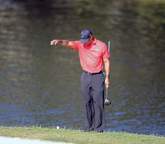 Woods took a drop after hitting his tee shot into the pond on the 14th hole. He went on to make a double bogey -- and allow several competitors back into the tournament.