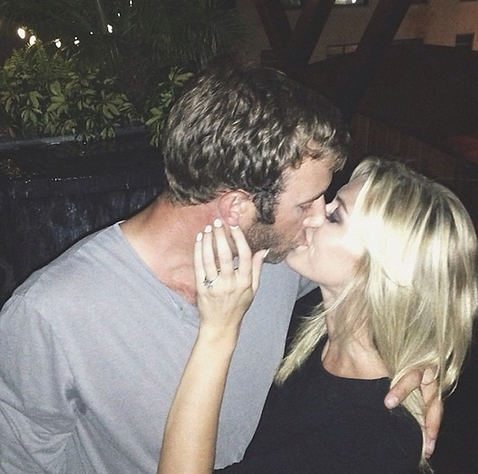 On August 17, 2013, Paulina Gretzky posted this photo on her Instagram account, announcing her engagement to Dustin Johnson.