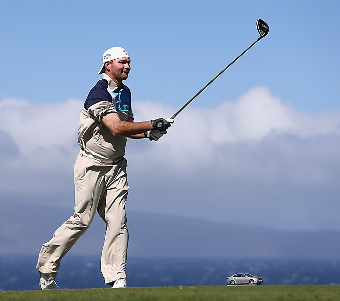 """Tommy """" Two Gloves"""" Gainey also elected to flip his hat backward to fight the wind."""