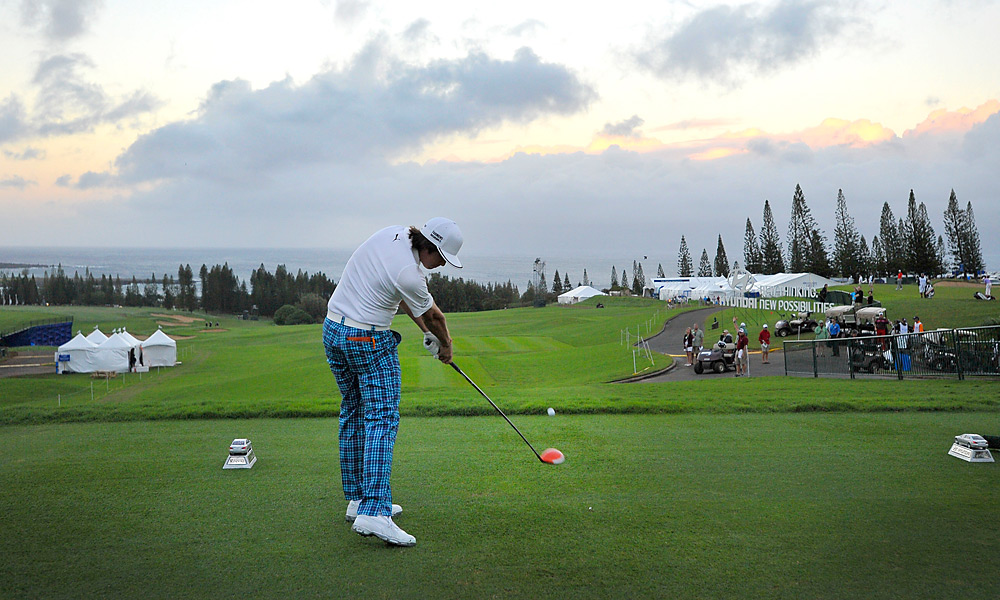 After three days of waiting out weather delays, Rickie Fowler hit the first official shot of the 2013 season Monday morning at Kapalua. Fowler shot a three-under 70, as pros endured 30-mph wind gusts.