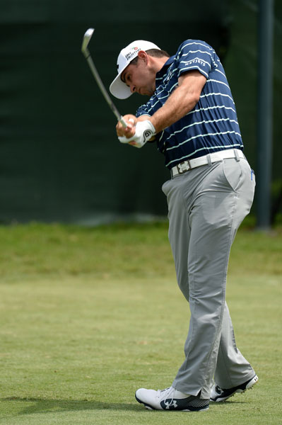 Gary Woodland rips an iron on the first hole of the third round.