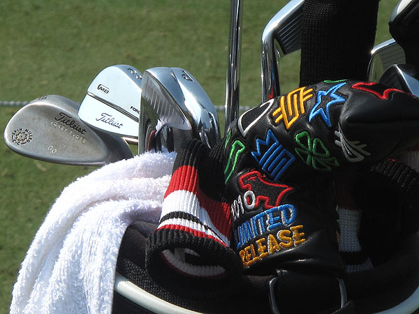 Geoff Ogilvy adds a splash of color to his bag with a Scotty Cameron putter cover that has dollar signs, four-leaf clovers, crowns and other Cameron logos stiched into it. Ogilvy collects them.