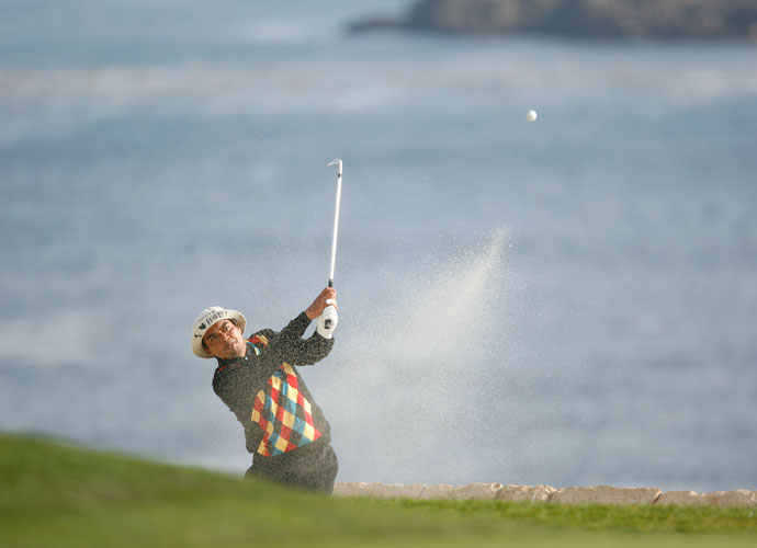 George Lopez blasts out of a bunker during the AT&T Pebble Beach National Pro-Am. The actor is a 10.9 at Lakeside Golf Club.