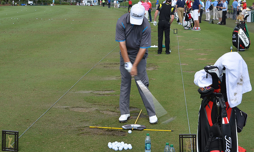 To improve his alignment and position at address, Greg Chalmers practiced with a mirror and two rods.