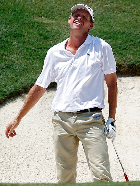 What, Anders Hansen worry?  Major championship or not, the laid-back Dane wore a white Lacoste shirt (with the top two buttons open and collar askew), wrinkled khakis, a plain black belt and beat up black golf shoes — three days in a row!  By Sunday he looked as if he had just rolled out of a sand trap after a monster bender.