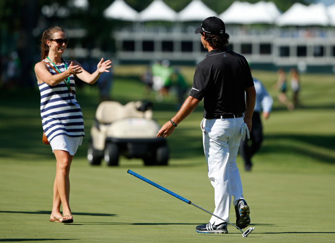 Harman celebrates with his fiance Kelly Van Slyke on the 18th green.