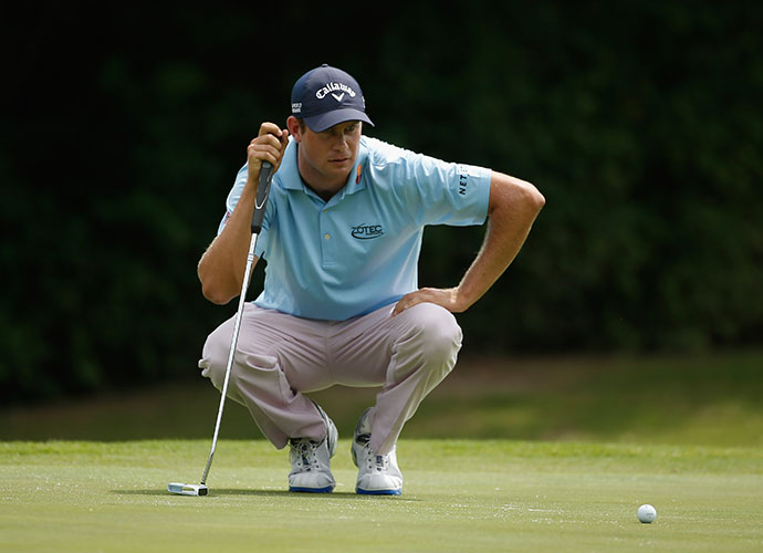 Harris English surveys a putt on the 11th. He birdied two of his last three holes to match Mahan at 4-under.