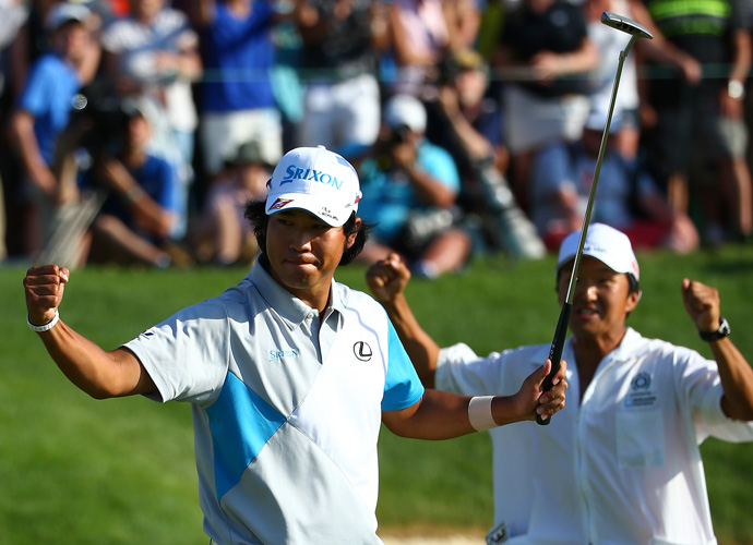 Matsuyama celebrates with his caddie on the 18th green.