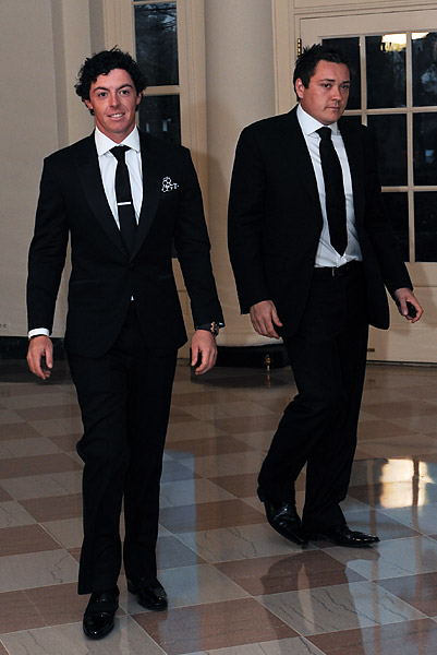 """Rory McIlroy and Conor Ridge, right, of Horizon Sports Management, which represented McIlroy until May 2013 when the young golfer left to form his own management company. McIlroy filed suit against Horizon in October, claiming that he was misled into signing an unbalanced contract """"in circumstances of great informality"""" at the company's Christmas party. Horizon is countersuing."""