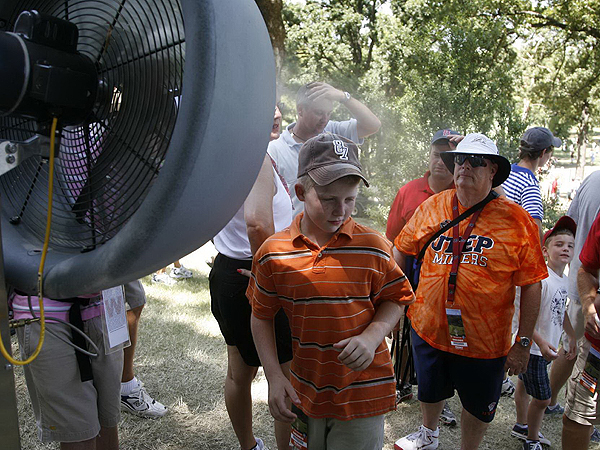 With temperatures once again nearing triple digits, fans at Southern Hills flocked to shade, fans and water to stay cool.