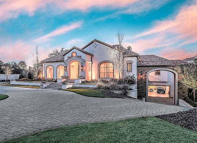 Hunter and Kandi Mahan's Dallas-area home is listed for $9.5 million. The 16,655-square-foot custom-built house is in the Preston Hollow neighborhood.