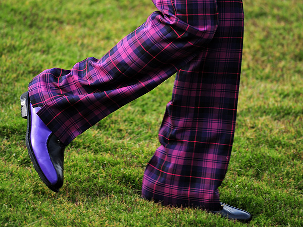 In a bygone era Poulter would have been called a dandy or a swell. From his spiked hair and tinted Oakley shades down to his notched tartan trousers and custom FootJoys, his on-course style has no match (although he does have emulators, chiefly Ryo Ishikawa).