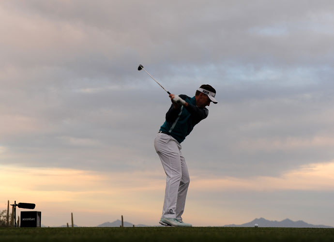 Ian Poulter hits a tee shot to begin his match against Rickie Fowler. Poulter won the match play in 2010.
