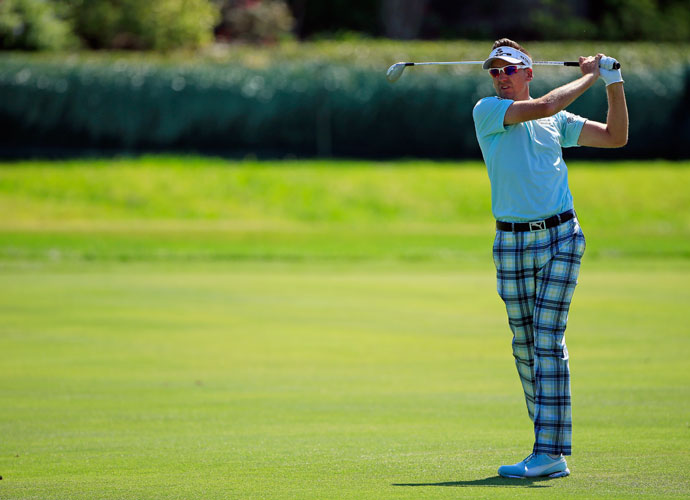 Ian Poulter follows through on his shot on the fourth hole. Poulter, who shot 71, was -5, nine shots back of the lead.