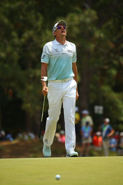 Ian Poulter looks skyward after missing a putt in the third round.